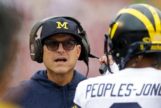 Michigan head coach Jim Harbaugh talks with receiver Donovan Peoples-Jones during the first half against Wisconsin, Saturday, Sept. 21, 2019, in Madison, Wis.