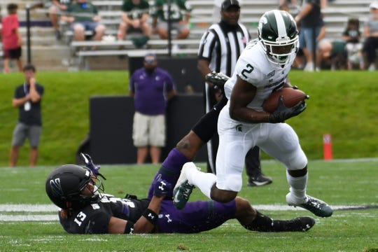 Michigan State receiver Julian Barnett is tackled by Northwestern defensive back JR Pace during the second half Saturday, Sept. 21, 2019, in Evanston, Ill.