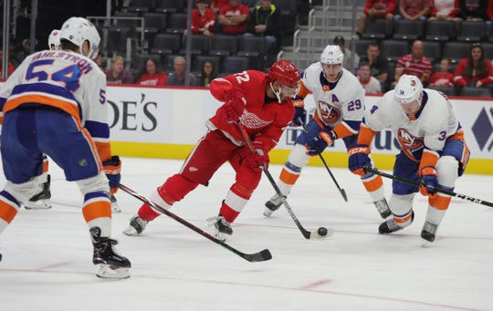 Red Wings left wing Andreas Athanasiu skates by Islanders defenders to score on goalie Semyon Varlamov during the first period of the preseason game on Friday, Sept. 20, 2019, at Little Caesars Arena.