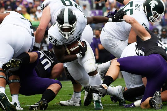 Michigan State running back Elijah Collins runs for a touchdown against Northwestern during the first half Saturday, Sept. 21, 2019, in Evanston, Ill.