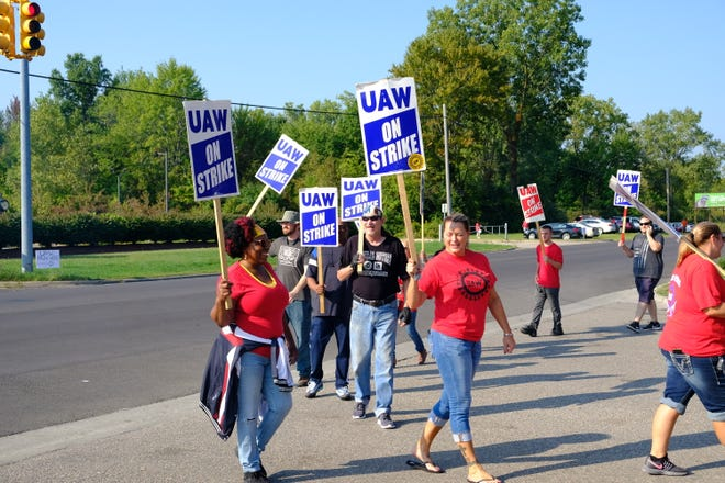 UAW Local 163 members protest outside General Motors Co.'s Romulus Engine Plant on Saturday, the sixth day of the union's national strike against the automaker.
