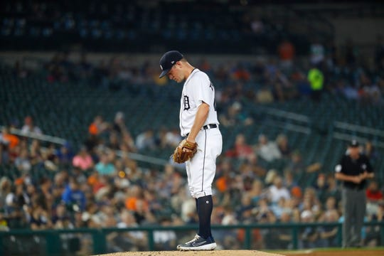 Tigers pitcher Jordan Zimmermann (27) stands on the mound after giving up a two-run home run to Chicago White Sox's Yoan Moncada in the third inning.