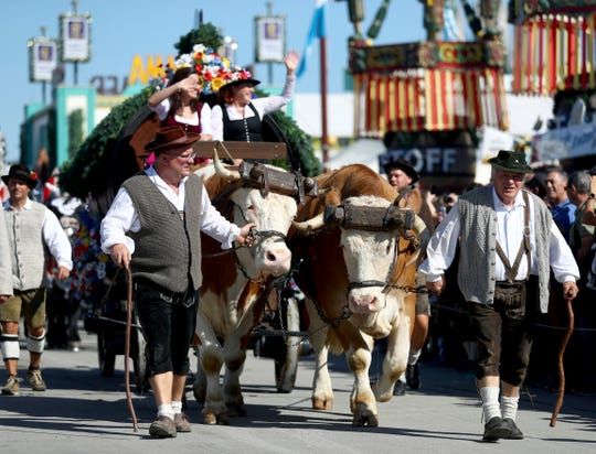 People in traditional costumes take part in a parade as part of the opening of the 186th 'Oktoberfest' beer festival Saturday in Munich.