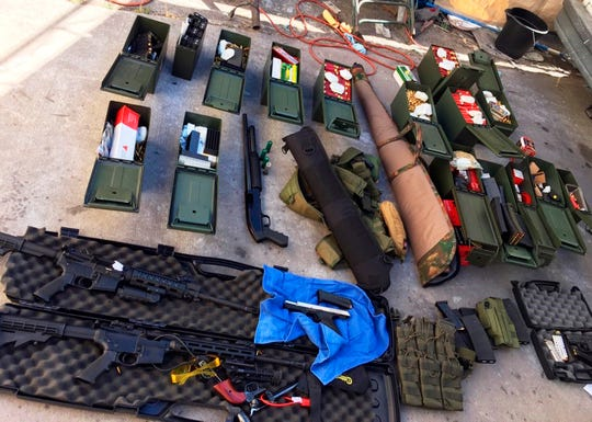 Weapons and ammunition seized from a cook at a Los Angeles-area hotel who allegedly threatened a mass shooting.
