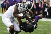 Michigan State receiver Darrell Stewart Jr. (25) catches a pass as Northwestern defensive back Cameron Ruiz (18) defends him during the second half on Saturday.