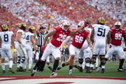 Wisconsin safety Eric Burrell celebrates after recovering a Michigan fumble near the end zone in the first quarter.
