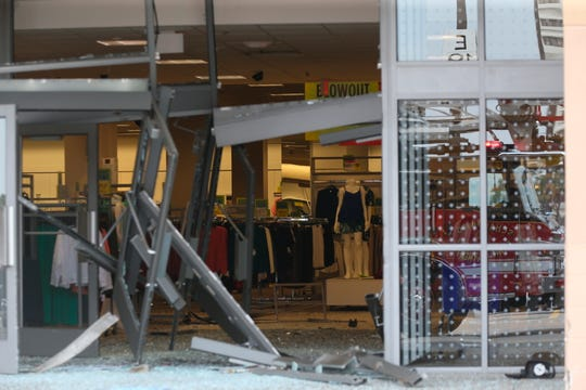 The damaged storefront of the Sears store at Woodfield Mall is seen after a man drove an SUV into the store in the Chicago suburb of Schaumburg, Ill., on Friday, Sept. 20, 2019.