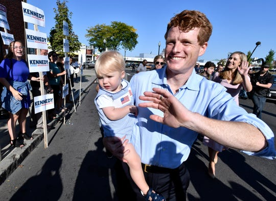 Democratic U.S. Rep. Joseph Kennedy III, D-Mass., waves to supporters as he arrives with family members, from left, his son James Kennedy, 1, and wife Lauren Kennedy, in East Boston to announce his candidacy for the Senate on Saturday, Sept. 21, 2019, in Boston.