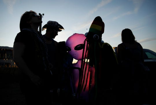 People stand around an inflatable alien at an entrance to the Nevada Test and Training Range near Area 51, Friday near Rachel, Nev.