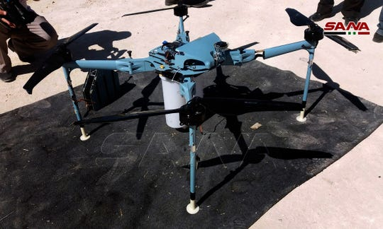 A drone which the Syrian state news agency says authorities have controlled and dismantled was rigged with cluster bombs on the edge of the Israeli-occupied Golan Heights, southern Syria, Saturday, Sept. 21, 2019.