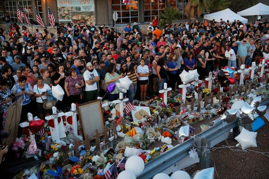 People crowd around a makeshift memorial at the scene of a mass shooting at a shopping complex in El Paso, Texas on Aug. 6, 2019.