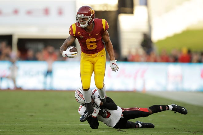 USC receiver Michael Pittman Jr. (6) is tackled by Utah defensive back Tareke Lewis during the first half on Friday.