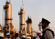 During a trip organized by Saudi information ministry, a security guarder stands alert in front of Aramco's oil processing facility after the recent Sept. 14 attack on Aramco's oil processing facility in Abqaiq, near Dammam in the Kingdom's Eastern Province, Friday, Sept. 20, 2019.
