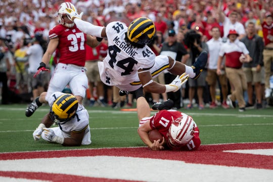 Wisconsin gashed Michigan's defense for 487 yards and five rushing scores on Saturday.