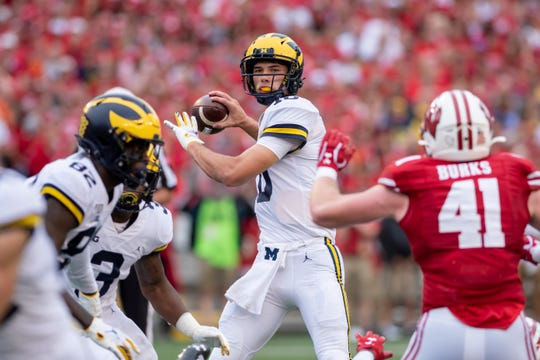 Michigan quarterback Dylan McCaffrey throws a pass in the third quarter.