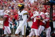 Michigan defensive back Vincent Gray looks away as Wisconsin celebrates a touchdown by quarterback Jack Coan late in the second quarter.