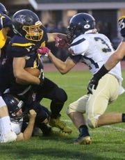 Elmira Notre Dame's Riley Hart tackles Trumansburg's Bryce Grove during the Crusaders' 30-12 victory Sept. 20, 2019 at Trumansburg.