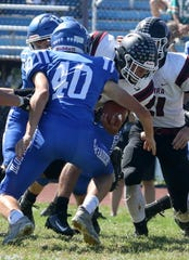 Ethan Simpson carries the ball for Elmira in a 34-28 win over Horseheads on Sept. 21, 2019 at Horseheads High School.