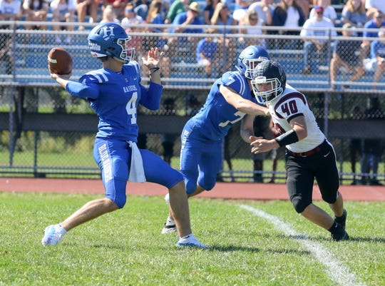 Horseheads quarterback Grayson Woodhouse passes as Elmira's Lucas Allen rushes while being blocked by Gavin Elston on Sept. 21, 2019 at Horseheads High School.