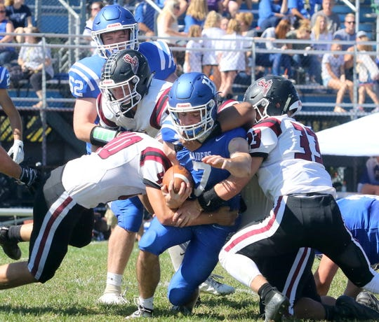 Gavin Elston of Horseheads is brought down by Elmira's Lucas Allen (40) and Tyler Marks (33) on Sept. 21, 2019 at Horseheads High School.