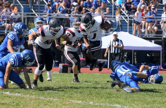 Elmira's Michael Brown jumps through the air during a rush against Horseheads on Sept. 21, 2019 at Horseheads High School.