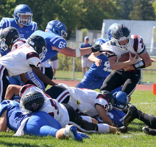 Nate Latshaw of Elmira carries the ball as Gannon Johnston of Horseheads tries for the tackle Sept. 21, 2019 at Horseheads High School.