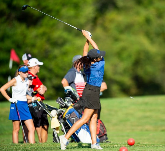 Memorial's Mallory Russell tees off at the IHSAA girls golf sectional at Fendrich Golf Course in Evansville, Saturday morning, Sept. 21, 2019.