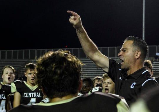 Central Head Coach Sean Coultis talks to his team following their 38-7 victory over the Castle Knights during the homecoming game at Central Stadium in Evansville, Ind., Friday, Sept. 20, 2019.