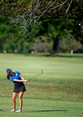 Memorial's Mallory Russell takes a shot in the sectional last week at Fendrich. The senior shot a 6-under 66 to win the regional at Country Oaks.