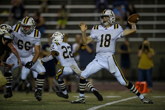 Castle's Nathan Harpenau (18) makes a pass during the first quarter against the Central Bears at Central Stadium in Evansville, Ind., Friday night, Sept. 20, 2019. The Bears defeated the Castle Knights, 38-7.