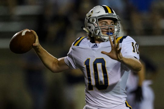 Castle's Cameron Justus (10) looks to make a pass during the second quarter against the Central Bears at Central Stadium in Evansville, Ind., Friday night, Sept. 20, 2019. The Bears defeated the Castle Knights, 38-7.