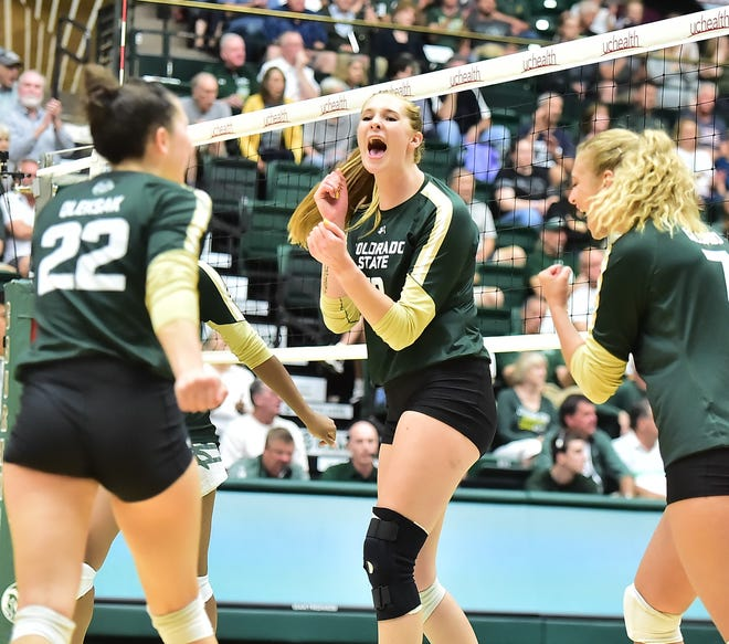 CSU volleyball player Kirstie Hillyer, middle, shown in a match earlier this season. Hillyer recorded her 1,000th career kill in Thursday's win over Fresno State.