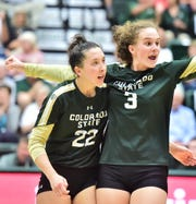 CSU volleyball players Katie Oleksak, left, and Olivia Nicholson celebrate a point during a win over Oregon State on Friday, Sept. 20, 2019, at Moby Arena.