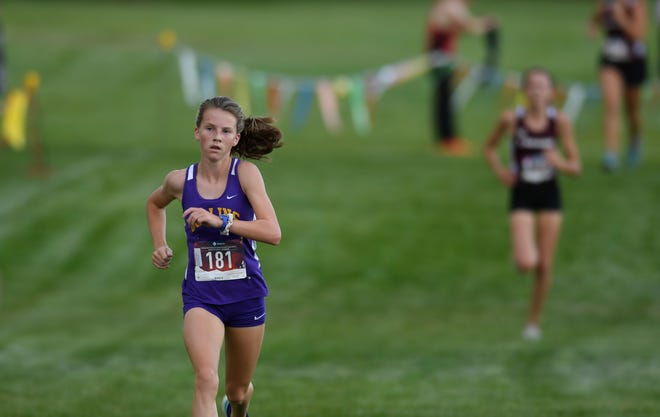 Fort Collins' Anne Sullivan races to the finish line in the John Martin Invitational at Fort Collins High School in Fort Collins, Colo. on Friday, Sept. 20, 2019.