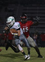 Game action between Fort Myers High School and South Fort Myers on Friday at South. Fort Myers beat South 35-16.