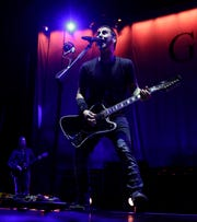"Godsmack frontman Sully Erna performs Friday at the Resch Center. The band opened with ""When Legends Rise."""