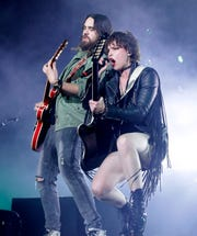 Halestorm guitarist Joe Hottinger, left, and singer Lzzy Hale perform ahead of Godsmack Friday night at the Resch Center.
