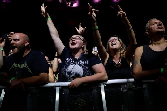 Fans cheer as Godsmack hits the Resch Center stage on Friday night.
