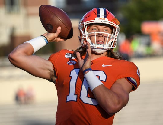 Clemson quarterback Trevor Lawrence (16) practices passing before the game at Memorial Stadium in Clemson, South Carolina Saturday, September 21, 2019.