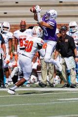 Furman's Ryan DeLuca (83) catches a pass for a first down against Mercer on Saturday. DeLuca finished with two receptions for 46 yards.
