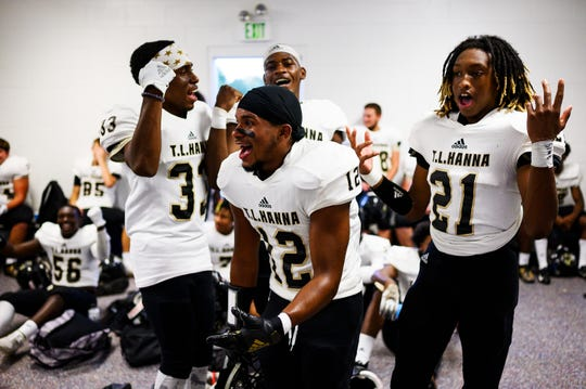 T.L. Hanna players hype each other up in the locker room before their game against J.L. Mann Friday, Sept. 20, 2019.