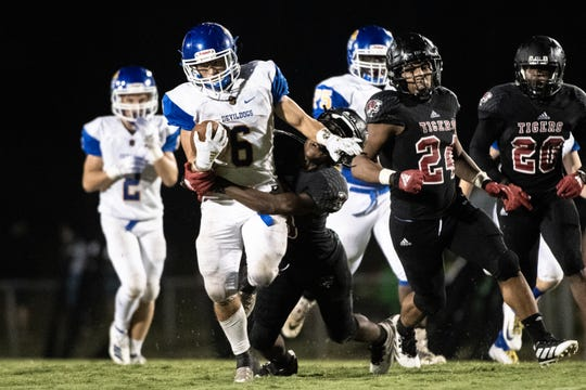 Travelers Rest's Cam Henderson (6) attempts to break a tackle by Blue Ridge's Jeremiah Mayfield (13) during their Friday night football game, September 20, 2019. Travelers Rest won 41-20.