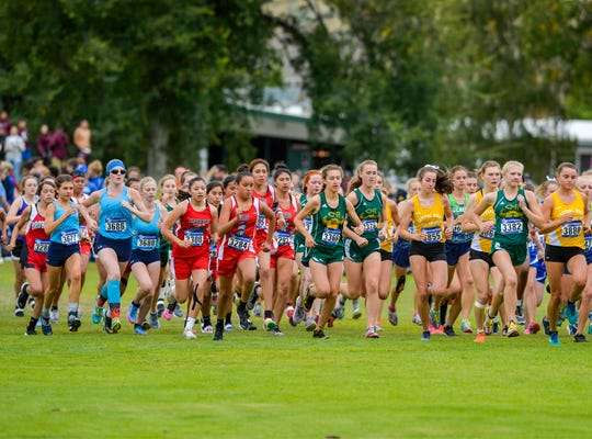The Girls AA race during the Great Falls Invitational Cross Country Meet, featuring hundreds of runners from large and small schools around the state, gets underway at Eagle Falls Golf Course, Friday, September 20, 2019.