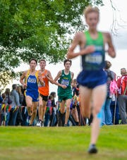 Fergus' Sam Fulbright, no. 2540, and CMR's Connor O'Hara, no. 3404, run the course at Eagle Falls Golf Course during the Great Falls Invitational Cross Country Meet, Friday, September 20, 2019.