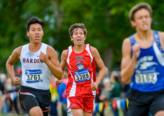 Browning's Justin Burd races in the Great Falls Invitational Cross Country Meet, featuring hundreds of runners from large and small schools around the state, at Eagle Falls Golf Course, Friday, September 20, 2019.