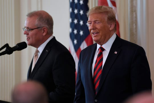 President Donald Trump and Australian Prime Minister Scott Morrison arrive for a news conference in the East Room of the White House in Washington, Friday, Sept. 20, 2019. (AP Photo/Susan Walsh)