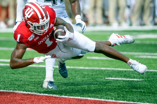 Indiana Hoosiers wide receiver Whop Philyor (1) scores a touchdown during the game against UConn at Memorial Stadium in Bloomington, Ind., on Saturday, Sept. 21, 2019.