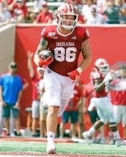 Indiana Hoosiers tight end Peyton Hendershot (86) scores a touchdown during the game against UConn at Memorial Stadium in Bloomington, Ind., on Saturday, Sept. 21, 2019.