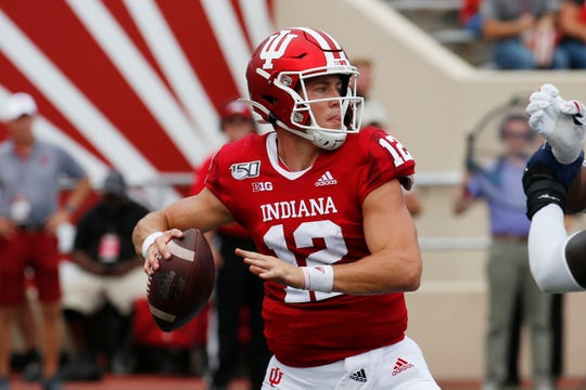 Indiana Hoosiers quarterback Peyton Ramsey (12) throws a pass against the Connecticut Huskies during the second quarter at Memorial Stadium .