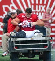 Indiana Hoosiers offensive lineman Coy Cronk (54) rides off the field on a cart during the game against UConn at Memorial Stadium in Bloomington, Ind., on Saturday, Sept. 21, 2019.